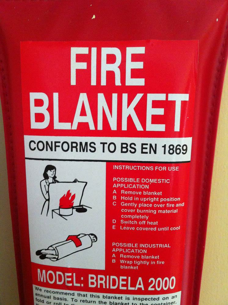 Install a fire extinguisher and fire blanket